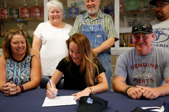 Piedra Vista outfielder Becca Goodwin signs her national letter of intent on Monday to continue her softball career at South Mountain Community College in Phoenix.