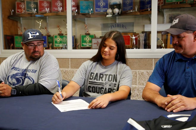 Piedra Vista pitcher Ashlee Lucero signs her national letter of intent on Monday to continue her softball career at Barton Community College in Great Bend, Kansas.
