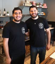 Rye Guys Deli owner Max Siba, right, and co-worker David Meza.