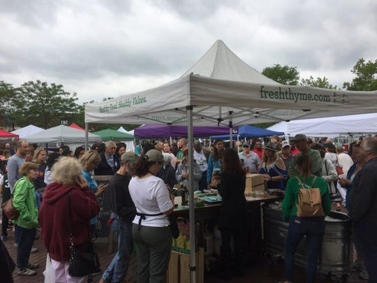 "Last Saturday was the annual farmers market ""Fit as a Fiddle"" Healthful Awareness Fair in downtown Farmington. A crowd gathers to learn all about the making of mason jar salads hosted by Fresh Thyme."