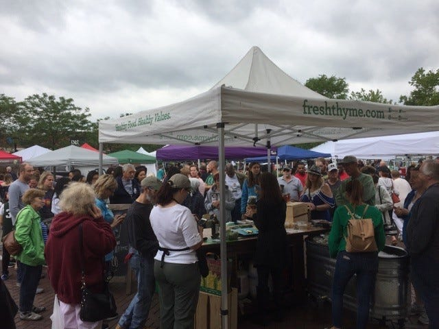 """Last Saturday was the annual farmers market """"Fit as a Fiddle"""" Healthful Awareness Fair in downtown Farmington. A crowd gathers to learn all about the making of mason jar salads hosted by Fresh Thyme."""