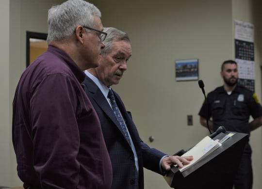 To the far left, former Westland priest Patrick Casey recently appeared in 18th District Court with his attorney because of a felony criminal sexual conduct charge.
