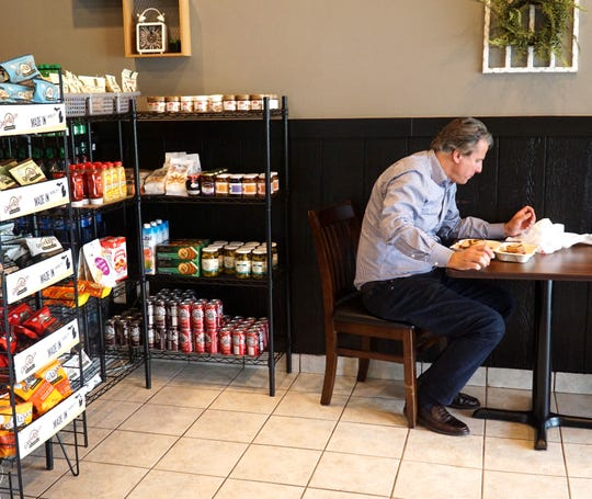 A customer enjoys a lunch on June 17 at Bloomfield Township's Rye Guys Deli.