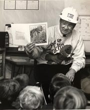 Jim Doyle reads to a kindergarten class in the Huron Valley School district. He served as superintendent from 1983-1998 and died June 15, 2019.