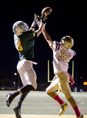 Jay Rudolph (8) of the Horizon Huskies catches a pass for a touchdown against Notre Dame Prep at Horizon High School on Oct. 5.
