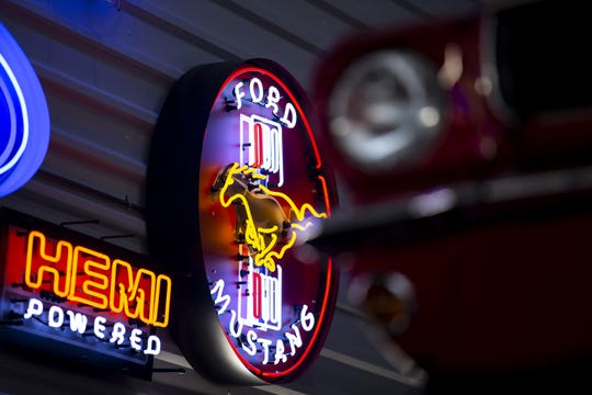 Neon signs hang inside a luxury garage unit on Wednesday, June 12, 2019, at Toy Barn in Cave Creek.
