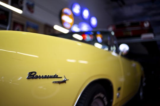A Plymouth Barracuda is pictured inside a luxury garage unit on Wednesday, June 12, 2019, at Toy Barn in Cave Creek.