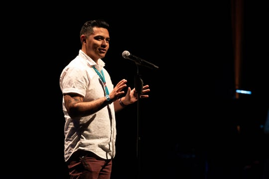 Kyle Mitchell tells his tale during the Arizona Storytellers Project presents My Culture, My Identity at the Scottsdale Center for Performing Arts on Wednesday, Jun. 12, 2019.