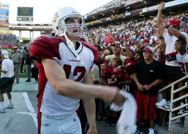 Cardinals quarterback Josh McCown tosses a towel to fans after being the Titans in a game on Oct. 23, 2005.