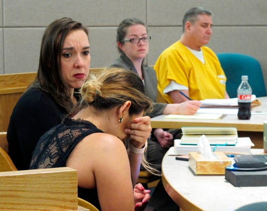 "Maria Gonzalez, foreground, wipes tears as she speaks on Monday, June 17, 2019, in Juneau, Alaska, during the sentencing hearing of Mark Desimone, right rear, who was convicted last year in the 2016 shooting death of her husband, Duilio Antonio ""Tony"" Rosales."