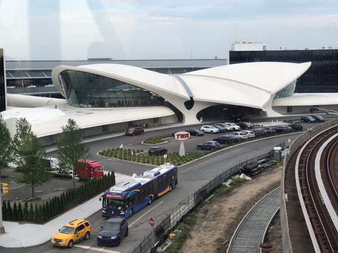 A view from the AirTrain of the newly restored TWA terminal at John F. Kennedy International Airport in New York. Now a hotel, it's like entering a time machine and you don't have to be a guest to experience it.