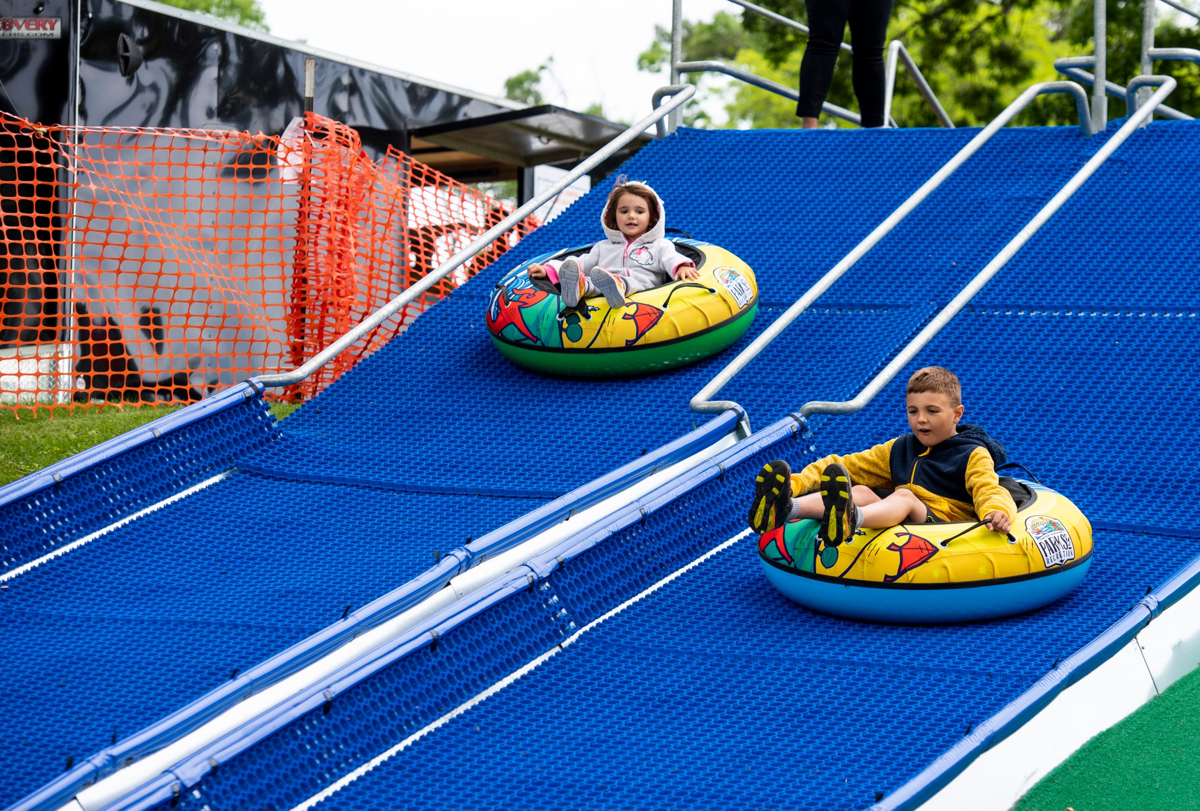 Charlie Lutrell, 7, and his sister Ava, 4, ride innertubes down the Super Slide at Palmer Park Monday, June 17, 2019.  The slides are free to use for anyone 4 and older.
