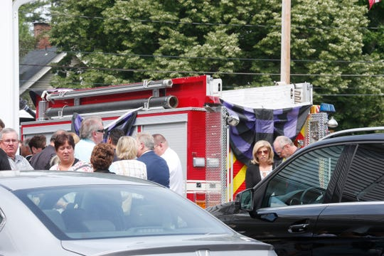 Mourners for Tim McCormack outside William G. Miller & Son Funeral Home in the Town of Poughkeepsie on June 17, 2019. McCormack, the helicopter pilot who was involved in a fatal crash in Manhattan on June 10 was a  former fire chief at East Clinton Fire District.