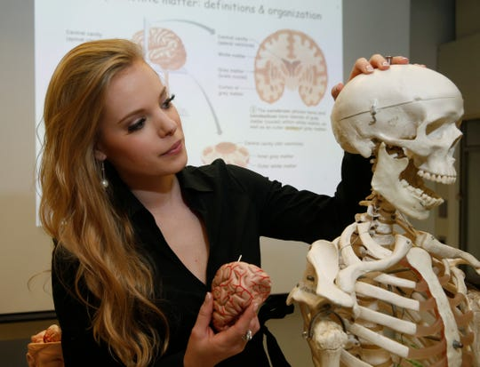 Lauren Molella, winner of the 2019 Miss New York pageant describes what happens when a person gets a concussion while in a biology lab at Dutchess Community College in the Town of Poughkeepsie on June 14, 2019. Molella, an adjunct professor of Biology is a Millbrook native, and