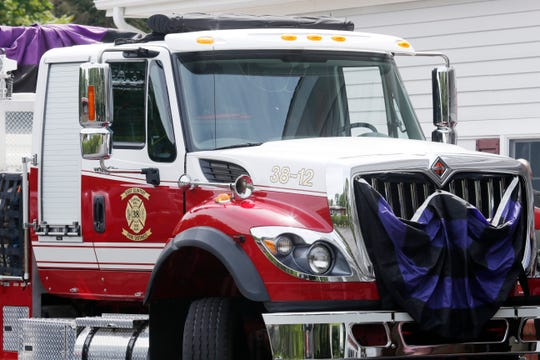 Memorial bunting covers a fire engine from East Clinton Fire District in honor of Tim McCormack at William G. Miller & Son Funeral Home in the Town of Poughkeepsie on June 17, 2019. McCormack, the helicopter pilot who was involved in a fatal crash in Manhattan on June 10 was a  former fire chief at East Clinton Fire District.