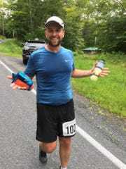 Christopher Regan runs in the Catskill Mountain 100K. He and his timing company, Mid Hudson Timing, has made the investment in equipment to make highly accurate and very fast timing in local races happen.