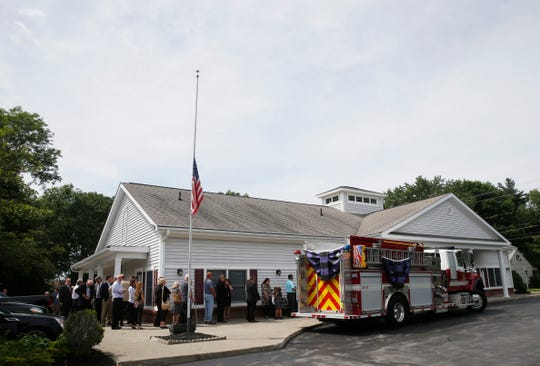 Mourners gather to pay their respects to Tim McCormack at William G. Miller & Son Funeral Home in the Town of Poughkeepsie on June 17, 2019. McCormack, the helicopter pilot who was involved in a fatal crash in Manhattan on June 10, was a  former fire chief at East Clinton Fire District.