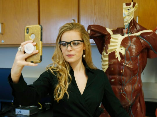 Lauren Molella, takes a selfie with an anatomical model while in a biology lab at Dutchess Community College in the Town of Poughkeepsie on June 14, 2019. Molella is an adjunct professor of Biology.