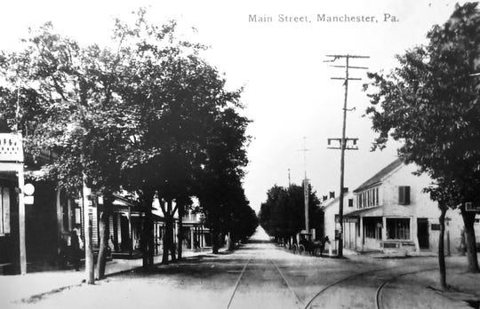 A picture of Main St. taken between the early 1900s and late 1920s.