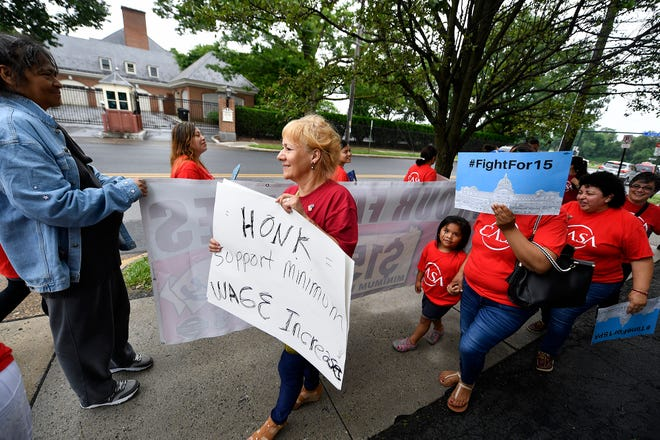 About twenty people from CASA rally outside the Governor's Mansion in Harrisburg in support of Governor Wolf's minimum wage hike proposal, Monday, June 17, 2019.John A. Pavoncello photo