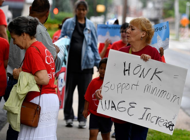 About twenty people from CASA rally outside the Governor's Mansion in Harrisburg in support of Governor Wolf's minimum wage hike proposal, Monday, June 17, 2019.