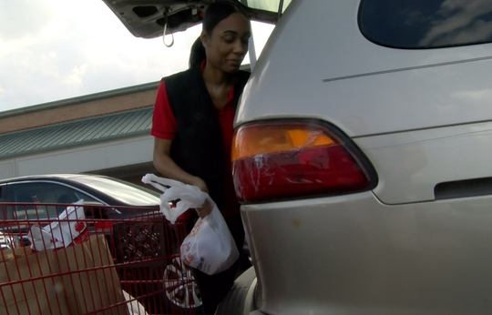 Mykia Day delivers a customer's groceries to her car at Weis Markets in West Manchester Township. Shoppers can fill out their grocery lists online earlier in the day and pick up the items approximately four hours later.