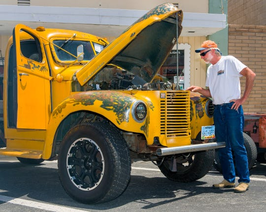 Earle Trimble, of Wellington, looks at a 1941 International pickup owned by Jarrod Haggard.