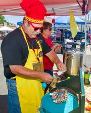 Mark Groth, from Sacramento, adds some seasoning to his Wow Wow Chili entry.