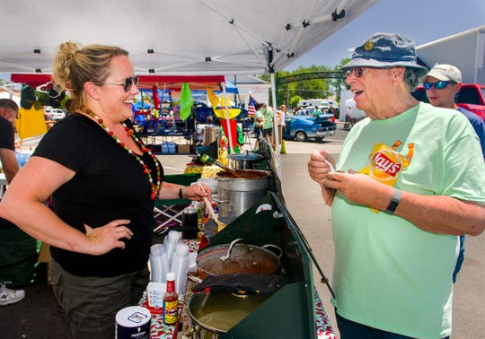 Richard Ernst, of Yerington, right, talks to Amy Lind, of Auburn, at The Young and the Beanless chili booth.