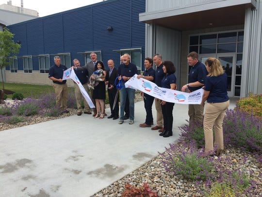 Bill Bishop, a founder of Blue Buffalo, cut the ceremonial ribbon Monday, June 17, 2019, at Blue Buffalo's Richmond plant.