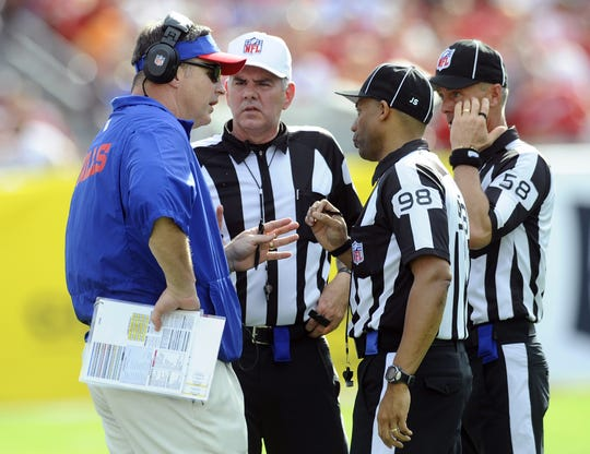 Jimmy DeBell (far right) retired as an NFL official after the 2015 season. Here he's shown in conversation with former Bills coach Doug Marrone.