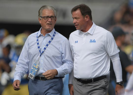 Sep 3, 2017; Pasadena, CA, USA; Fox Sports analyst Mike Pereira (lelft) talks with UCLA Bruins head coach Jim Mora before a NCAA football game against the Texas A&M Aggies at Rose Bowl. Mandatory Credit: Kirby Lee-USA TODAY Sports