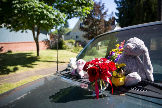 Flowers are placed on Karissa Fretwell's SUV outside her apartment in west Salem on June 14, 2019.