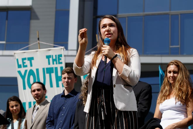 In this June 4, 2019, file photo, Kelsey Rose Juliana, of Eugene, Ore, speaks at a rally for a group of young people who filed an environmental lawsuit against the U.S. government in Portland, Ore. Oregon is on the precipice of becoming the second state after California to adopt a cap-and-trade program, a market-based approach to lowering the greenhouse gas emissions behind global warming.