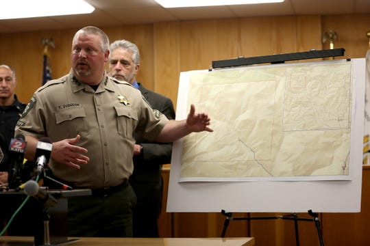 Yamhill County Sherriff Tim Svenson goes over a map where the bodies of Karissa Fretwell and William Fretwell were found in McMinnville on June 17, 2019. Their bodies were found on Saturday in rural Oregon.