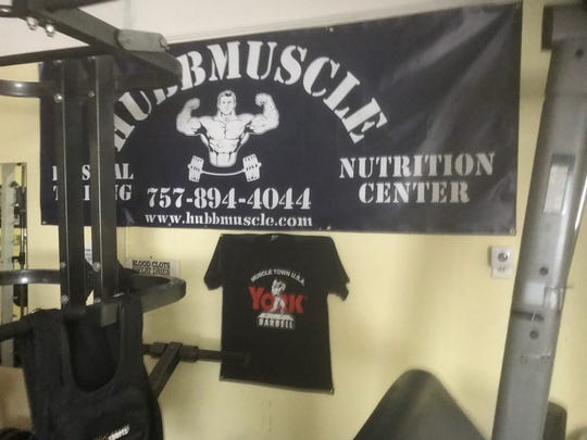 A banner is displayed on the wall inside Hubbmuscle Personal Training and Nutrition Center on Monday, June 17, 2019 in Chincoteague, Virginia.
