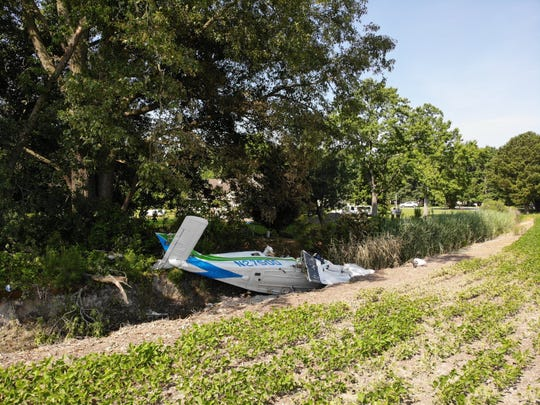 Dan Harrison took these photos of the private plane that crash landed early Saturday morning about 600 yards off the runway at Crisfield Municipal Airport.