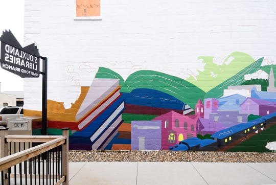 A mural is partially completed on a wall off Main Street Monday, June 17, in Hartford, SD.