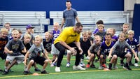 Hard-hitters stopped at Sanford Fieldhouse for defensive football camp on Monday