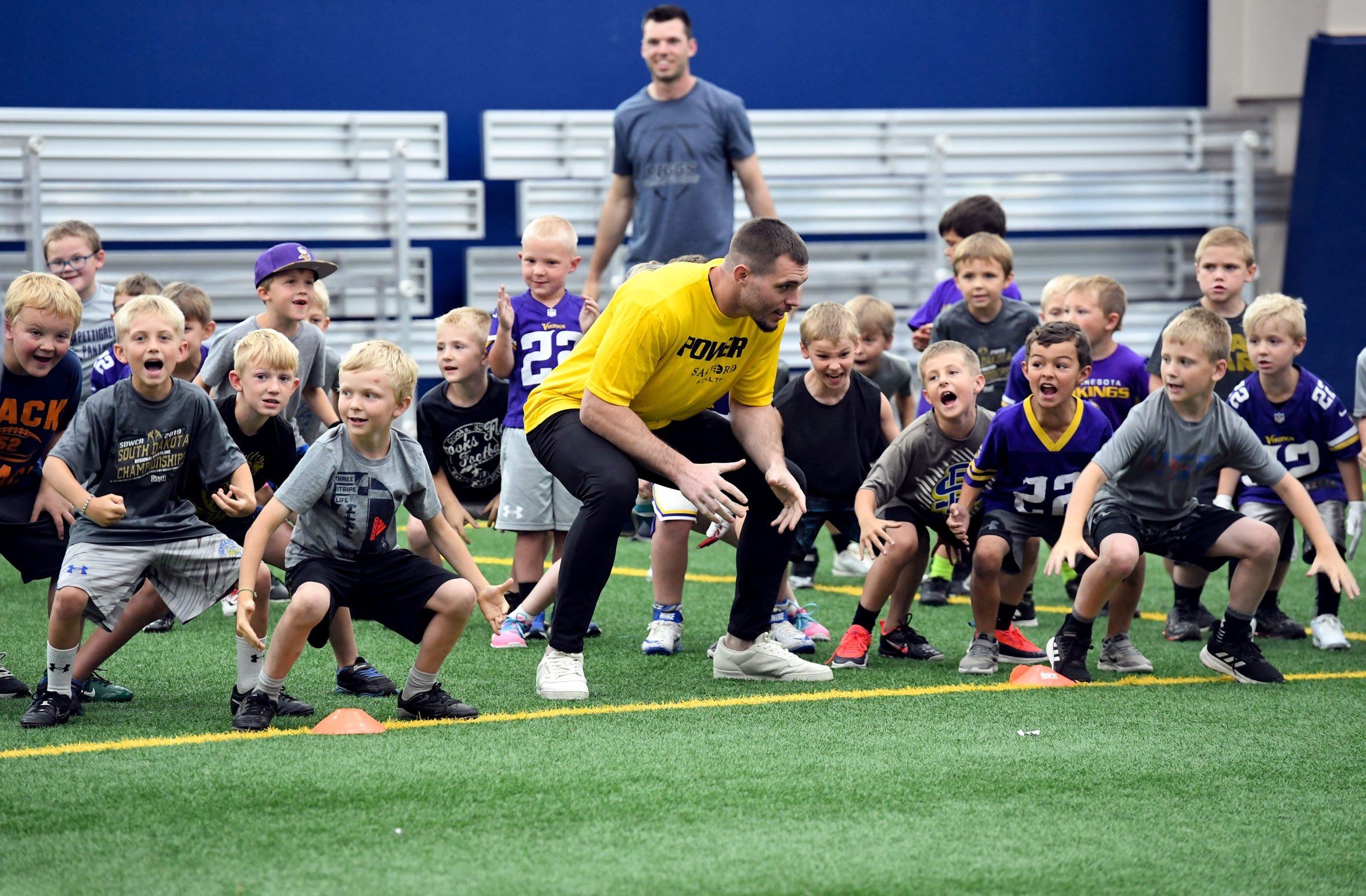 Minnesota Vikings safety Harrison Smith teaches a defensive stance at a youth football camp Monday, June 17, at the Sanford Fieldhouse in Sioux Falls.
