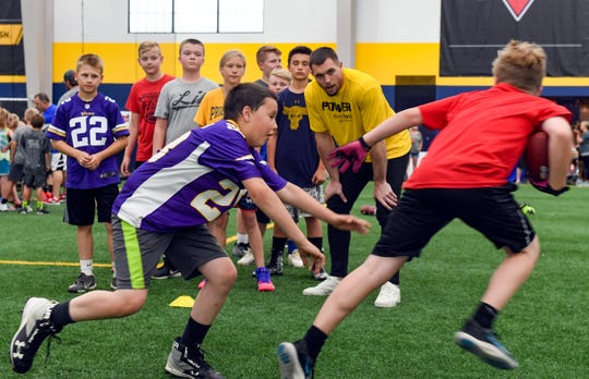 Minnesota Vikings safety Harrison Smith observes a defensive drill during a youth football camp Monday, June 17, at the Sanford Fieldhouse in Sioux Falls.