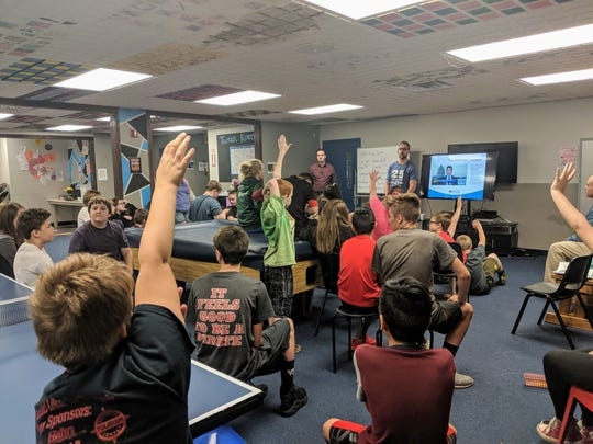 Boys and Girls Club of the Ozarks staff, Jon Follis and Josh Higgs, answer questions from club members during a recent vaping presentation.