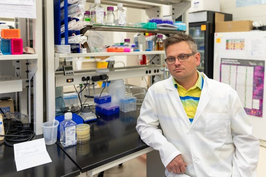 Dr. Brandon Jutras, assistant professor in the Department of Biochemistry, poses for a portrait in his lab.