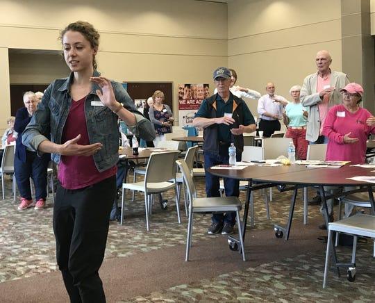 Juniper Program Developer Rachel Von Ruden demonstrates Tai Ji Quan: Moving for Better Balance at a senior seminar at St. Michael City Hall on June 14, 2019.