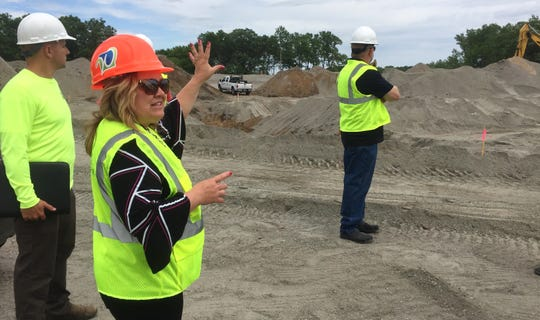 Waite Park City Administrator Shaunna Johnson gives a tour of the amphitheater construction site to city officials Monday, June 17.