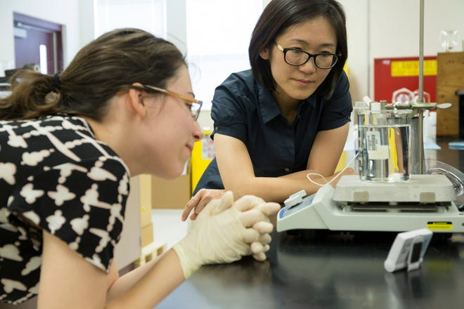 Yu Wang's, right, working in her lab with graduate student Veronica Lagor. They will study how orange peels promote gut health.
