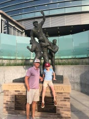 Former FSU pitcher Michael Hyde and son Easton in Omaha, Nebraska, for the College World Series.
