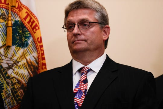 Leon County Supervisor of Elections Mark Earley attends a news conference held to announce a partnership between the Governor's office, the Department of State and the 67 county supervisors of elections to examine potential election and cybersecurity issues at the Capitol Monday, June 17, 2019.