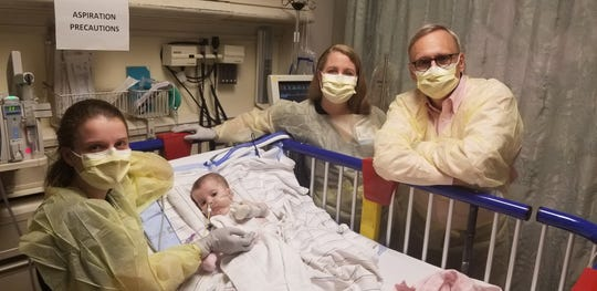 Karen Wright (left), Londyn Wright, nurse practitioner Kara Godwin Wild and Barry Byrne, M.D., Ph.D., in the pediatric intensive care unit at University of Florida Health Shands Children's Hospital on June 7 — Londyn's gene therapy infusion day.