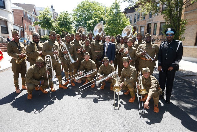 """The 369th Experience, a WWI tribute band sponsored by the U.S WWI Centennial Commission, leads the Brooklyn Memorial Day Parade during Fleet Week New York, which this year is commemorating WWI, Monday, May 27, 2019, in New York. The band, which is made up of music students from Historically Black Colleges and Universities across the U.S., play the musical repertoire of New York's legendary 369th Regiment """"Harlem Hellfighters"""" Regimental Jazz Band."""